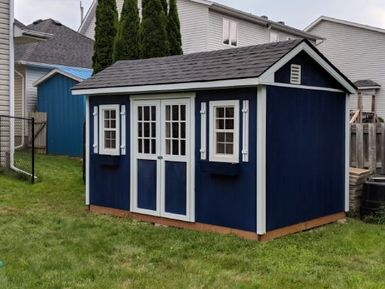 Custom Blue Haliburton Cottage Shed With White Trims
